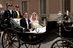 59793564 <br /> The newly wed Swedish Princess Madeleine and U.S. banker Christopher O Neill leave in a carriage after their wedding ceremony at the Royal Chapel in Stockholm, Sweden, on June 8, 2013.. UK ONLY