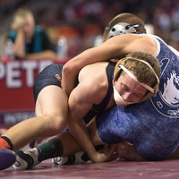 022115      Cayla Nimmo<br /> <br /> Kirtland Central Bronco Aidan Cockrell beats Armando Galindo from Silver 6-1 for the State Championship title in the 132 weight bracket on Saturday in Albuquerque.