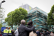 Emotional scenes durng the memorial service on the first anniversary of the Grenfell tower block disaster, on 14th June 2018, in London, England. 72 people died when the tower block in the borough of Kensington & Chelsea were killed in what has been called the largest fire since WW2. The 24-storey Grenfell Tower block of public housing flats in North Kensington, West London, United Kingdom. It caused 72 deaths, out of the 293 people in the building, including 2 who escaped and died in hospital. Over 70 were injured and left traumatised. A 72-second national silence was held at midday, also observed across the country, including at government buildings, Parliament.
