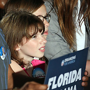 A young girl watches as President Barack Obama speaks during his Grassroots event at the Kissimmee Civic Center in Kissimmee, Florida on Saturday, September 8, 2012. (AP Photo/Alex Menendez)
