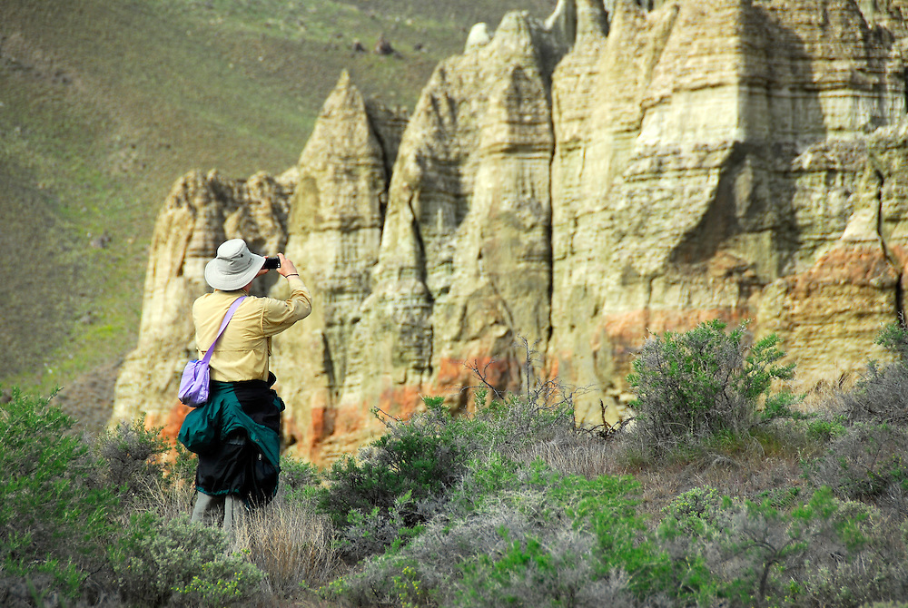 Photographing eroded badlands in Chaulk Basin, Owyhee River, Oregon.
