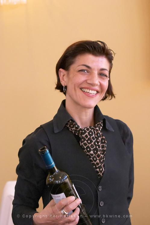 Smiling waitress serving wine at lunch. Wine Art Estate Winery, Microchori, Drama, Macedonia, Greece
