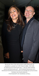 Musician PHIL COLLINS and his wife ORIANNE at a party in London on 12th March 2003.PHY 365