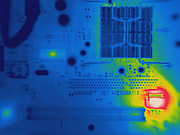 Thermogram of a computer board.  The different colors represent different temperatures on the object. The lightest colors are the hottest temperatures, while the darker colors represent a cooler temperature.  Thermography uses special cameras that can detect light in the far-infrared range of the electromagnetic spectrum (900?14,000 nanometers or 0.9?14 µm) and creates an  image of the objects temperature..