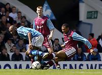Manchester City v West Ham United, FA Barclaycard Premiership, Maine Road, Manchester. 27/04/2003.<br />West Ham's Eduoard Cisse (R) slides in on Man City's Nicolas Anelka.<br />Photo:  Jed Wee, Digitalsport