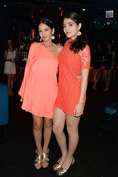 Left to right, YASMIN MILLS and her daughter MADDIE MILLS at a summer party hosted by Jo Wood & Yasmin Mills at Boujis, 43 Thurloe Street, London on 9th July 2014.