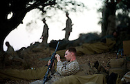 LCpL. Jonathan Newton, of New York, cleans his weapon during some downtime during live-fire exercises at Camp Pendleton last weekend.