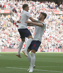 England's Gary Cahill (right) celebrates scoring his side's first goal of the game with Kieran Trippier during the International Friendly match at Wembley Stadium, London.