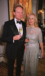 The DUKE OF ST.ALBANS and MRS PHILIP ROBERTS at an exhibition in London on 10th June 1999.MTB 20