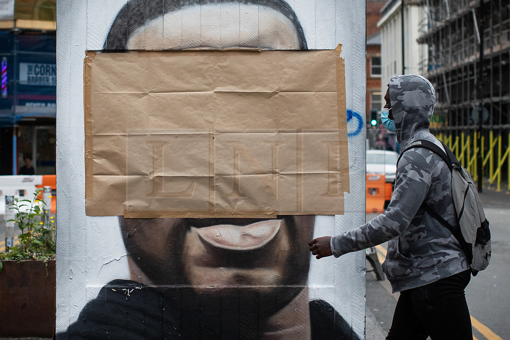 """© Licensed to London News Pictures . 22/07/2020 . Manchester , UK . A mural to George Floyd in the Northern Quarter of Manchester City Centre has been covered over after it was sprayed with racist graffiti . It's understood """" Nigger """" was sprayed across the face of the artwork by Manchester artist AKSE overnight . Photo credit : Joel Goodman/LNP"""