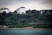 The View, a boutique hotel, refurbished in 2016 within the beautiful19th Century Victorian white terraced hotels and townhouses with Stucco architecture along Clifton Crescent and Clifton Road, to the right is the Band Stand on the Leas, Folkestone, Kent, United Kingdom.  Below is the Lower Leas Costal Park which leads down to the Mermaid Cafe and Mermaid beach front.  This was as elegant and fashionable destination for Victorian and Edwardian holidaymakers.  (photo by Andrew Aitchison / In pictures via Getty Images)