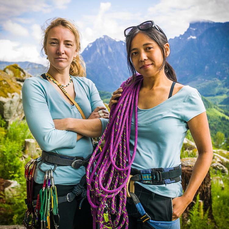 A portrait of Jenny Uehisa and Amy Leska bouldering at Zeek's Boulders in the Washington Cascades.