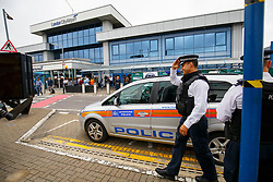 © Licensed to London News Pictures. 06/09/2016. London, UK. Police officers patrol outside London City Airport in east London as protestors from the Black Lives Matter group block the runway at London City Airport. All flights in and out of the airport are disrupted. Photo credit: Tolga Akmen/LNP