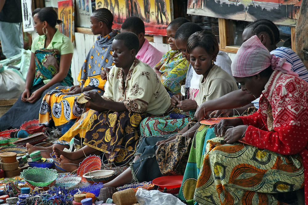 Merchants sell handcrafted wares at an open market in Tanzania.