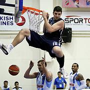 Anadolu Efes's Estaban Batista (C) during their Turkish Basketball league derby match  Fenerbahce Ulker between Anadolu Efes at Caferaga Sports Hall in Istanbul, Turkey, Saturday 01, 2012. Photo by TURKPIX