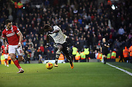 Fulham striker, Moussa Dembele (25) dribbling down wing during the Sky Bet Championship match between Fulham and Charlton Athletic at Craven Cottage, London, England on 20 February 2016. Photo by Matthew Redman.