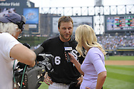 CHICAGO - JULY 23:  Mark Buehrle #56 of the Chicago White Sox talks to the media after recording the 18th perfect game in major league history against the Tampa Bay Rays on June 23, 2009 at U.S. Cellular Field in Chicago, Illinois.  The White Sox defeated the Rays 5-0.  (Photo by Ron Vesely)