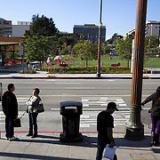 People wait for the Metro public transportation in Los Angeles.