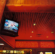 Interstate rest stop, New York State. Patriotic Americana - After 9/11. Television moment of President Bush visiting Ground Zero. In the week after the September 11th attacks, America sought to express their anger and patriotic unity. Seen on CNN at a rest-stop in New York State, President Bush visits the workers at Ground Zero next to Burger King..