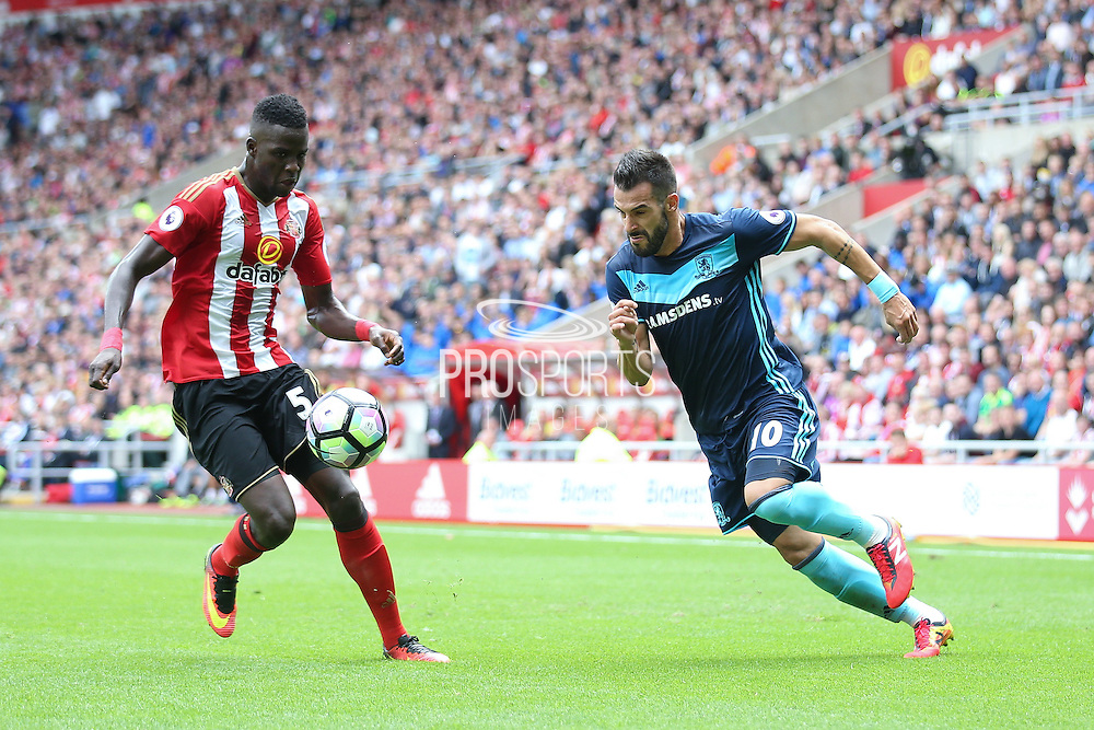 Sunderland defender Papy Djilobodji (5)  tries to stop Middlesbrough forward, on loan from Valencia, Alvaro Negredo (10)  during the Premier League match between Sunderland and Middlesbrough at the Stadium Of Light, Sunderland, England on 21 August 2016. Photo by Simon Davies.