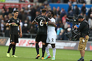 goalscorer Jamaal Lascelles of Newcastle Utd embraces Wilfried Bony of Swansea city  at the final whistle . Premier league match, Swansea city v Newcastle Utd at the Liberty Stadium in Swansea, South Wales on Sunday 10th September 2017.<br /> pic by  Andrew Orchard, Andrew Orchard sports photography.