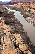"The ""mighty"" Colorado River, reduced to nearly a trickle, flows into the beginning of Lake Powell in Utah at the eastern end of the lake, Friday, March 14, 2003.  The inflow was measured at 5,000 cfs (cubic feet per second) while at the outflow end of the lake at the Glen Canyon Dam the water was being released at 12,800 cfs.  Lake Powell, already at 90 feet below a full pool continues to drop a foot every 4 to 5 days."