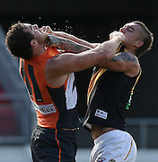 Shane Mumford of the Giants and Dustin Martin of the Tigers come to blows during the 2014 AFL Round 10 match between the GWS Giants and the Richmond Tigers at Spotless Stadium, Sydney on May 24, 2014. (Photo: Craig Golding/AFL Media)