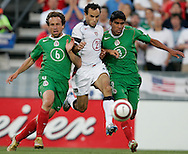 USA's Landon Donovan is double teamed by Mexico defenders' Carlos Salcido, left, and Gerrado Torrado, right, in the first half of the USA's 2-0 victory over Mexico to clinch a FIFA World Cup berth, in Columbus, OH, Saturday, Sept., 3, 2005.