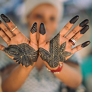 Woman with henna hands. Kayes, Mali.