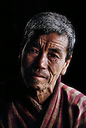Uncle Kinley Dorji, part of Namgay and Nalim's family in Shingkhey Village, Bhutan. Uncle Kinley is especially fond of children. From Peter Menzel's Material World Project.