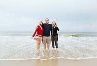 Portrait of siblings on a sandy beach. Delaware, USA.