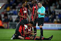 """AFC Bournemouth Lys Mousset receives treatment during the Carabao Cup, third round match at the Vitality Stadium, Bournemouth. PRESS ASSOCIATION Photo. Picture date: Tuesday September 19, 2017. See PA story SOCCER Bournemouth. Photo credit should read: Steven Paston/PA Wire. RESTRICTIONS: EDITORIAL USE ONLY No use with unauthorised audio, video, data, fixture lists, club/league logos or """"live"""" services. Online in-match use limited to 75 images, no video emulation. No use in betting, games or single club/league/player publications."""