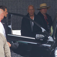 US actor Bruce Willis (2nd R) is seen among members of the cast as he leaves the scene with a car after a shooting day of the fifth piece in the Die Hard series titled Good Day to Die Hard during a shooting day in Budapest, Hungary on May 19, 2012. ATTILA VOLGYI
