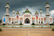 "Sept. 25, 2009 -- PATTANI, THAILAND: Storm clouds gather over the Central Mosque in Pattani, Thailand. The mosque's Imam said a special prayer on this day for the Thai King who is in a hospital in Bangkok. Pattani's Central Mosque is considered the most architecturally striking mosque in Thailand and was a leading tourist site until the current violence put an end to mass tourism in Pattani. Thailand's three southern most provinces; Yala, Pattani and Narathiwat are often called ""restive"" and a decades long Muslim insurgency has gained traction recently. Nearly 4,000 people have been killed since 2004. The three southern provinces are under emergency control and there are more than 60,000 Thai military, police and paramilitary militia forces trying to keep the peace battling insurgents who favor car bombs and assassination.  Photo by Jack Kurtz / ZUMA Press"