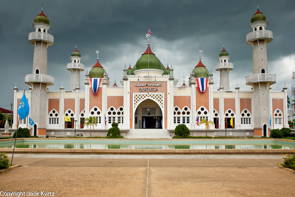 """Sept. 25, 2009 -- PATTANI, THAILAND: Storm clouds gather over the Central Mosque in Pattani, Thailand. The mosque's Imam said a special prayer on this day for the Thai King who is in a hospital in Bangkok. Pattani's Central Mosque is considered the most architecturally striking mosque in Thailand and was a leading tourist site until the current violence put an end to mass tourism in Pattani. Thailand's three southern most provinces; Yala, Pattani and Narathiwat are often called """"restive"""" and a decades long Muslim insurgency has gained traction recently. Nearly 4,000 people have been killed since 2004. The three southern provinces are under emergency control and there are more than 60,000 Thai military, police and paramilitary militia forces trying to keep the peace battling insurgents who favor car bombs and assassination.  Photo by Jack Kurtz / ZUMA Press"""