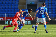 Cardiff City's Marlon Pack (21) under pressure from Nottingham Forest's Lewis Grabban (7) during the EFL Sky Bet Championship match between Cardiff City and Nottingham Forest at the Cardiff City Stadium, Cardiff, Wales on 2 April 2021.
