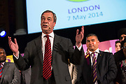 Nigel Farage, the leader of UKIP, The UK Indepenence Party, addresses the party faithful, campaigns as an anti racist party whilst against immigration and the EU. The front rows of the hall are filled with multi ethnic supporters to reinforce the message.