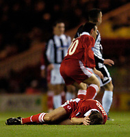 Photo. Jed Wee, Digitalsport<br /> Middlesbrough v Partizan Belgrade, UEFA Cup, 15/12/2004.<br /> Middlesbrough's Colin Cooper lies clutching his head following a collision with Partizan's Pierre Boya