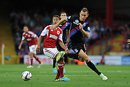 Aaron Wilbraham of Crystal Palace breaks away from Bristol city's Derrick Williams. Capital one cup match, 2nd round, Bristol city v Crystal Palace at Ashton Gate stadium in Bristol on Tuesday 27th August 2013. pic by Andrew Orchard , Andrew Orchard sports photography,