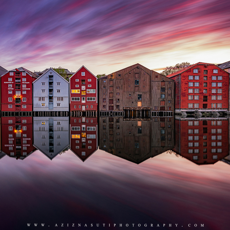 """website: www.azinasutiphotography.com      Ver special colors on Trondheim on 28 May 2018. I was very surprised to see such a strange but beautiful colors in the sky.         At Nidelva's outlet there have been seaside stalls, breweries and warehouses all the way from the oldest times. Here the towners traded with goods from far and near.<br /> <br /> At the time of King Sverres, the bridges were also used as defense works. Towards the river, screens and times were built. From here you could throw stones on the enemy. In Magnus Lagabøte's city council of 1276, it is stated that the swallow, a passageway outside the bridges, should not be wider than three ales; further that between the brews should be """"droplet"""" distance. The brewery that is still preserved is located on both sides of Nidelva - in Kjøpmannsgata, in Bakklandet, in Fjordgata and Sandgata. The oldest preserved breweries are from the mid-18th century."""