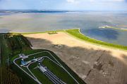 Nederland, Zeeland, Terneuzen, 09-05-2013; Zeeuws-Vlaanderen, Terneuzen, zuidelijk ingang van de Westerscheldetunnel (midden beneden in beeld). Westerschelde en Zuid-Beveland aan de horizon. Boerderij aan het water op een kale akker. Water van de Westerschelde klotst.<br /> Tunnel entrance (bottom, m) of the tunnel in the Westerschelde, connecting Zeeuws-Vlaanderen and Zuid-Beveland (on the horizon) in the province of Zeeland.<br /> luchtfoto (toeslag op standard tarieven);<br /> aerial photo (additional fee required);<br /> copyright foto/photo Siebe Swart.