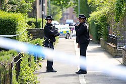 © Licensed to London News Pictures. 02/05/2019. London, UK. Police officers guard a large area of the crime scene on Somerford Grove in Hackney Downs in north London where a 15 years old was stabbed and pronounced dead at the scene at 9.49 pm on Wednesday 1 May 2019. Photo credit: Dinendra Haria/LNP