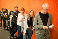 Queue and orange wall. Tate Modern Extension opening weekend, Bankside, London (18 June 2016) © Rudolf Abraham