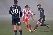 Stevenage midfielder Charlie Carter(7) and Swansea City midfielder Ryan Manning(3) battles for possession during the FA Cup match between Stevenage and Swansea City at the Lamex Stadium, Stevenage, England on 9 January 2021.