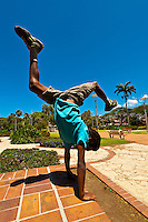 A Melanesian boy doing a handstand, Place des Cocotiers, Noumea, New Caledonia.