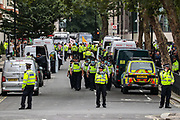 A group of police march towards Parliament Square from Marsham Street in London as two members of extinction Rebellion activists glued themselves outside Home Office in central London on Wednesday, Sept 2, 2020. Environmental activist group XR enters its 2nd day of climate change demonstrations, which they began on the first week of September. (VX Photo/ Vudi Xhymshiti)