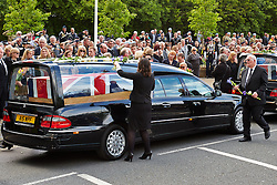 © Licensed to London News Pictures.  06/05/2014. CARTERTON, UK. Mourners pay their respects during the repatriation ceremony of c, Warrant Officer Spencer Faulkner and Cpl James Walters, all from the Army Air Corps, and RAF Intelligence Officer Flt Lt Rakesh Chauhan and L/Cpl Oliver Thomas both of the Intelligence Corps. The group died after a Lynx helicopter came down in the Takhta Pul district of Kandahar, some 30 miles from the Pakistan border, on 27 April. Photo credit: Cliff Hide/LNP