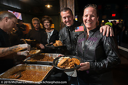 Longtime HOG members Sasha Moran and James Reinhold, originally of Belgium, enjoy the Sunday night HOG welcome party at the Full Moon Saloon that included a pulled pork dinner and a couple of drinks during the Daytona Bike Week 75th Anniversary event. FL, USA. Sunday March 6, 2016.  Photography ©2016 Michael Lichter.