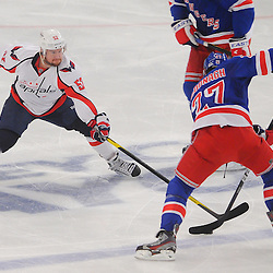 May 12, 2012: Washington Capitals defenseman Mike Green (52) pokes the puck away from New York Rangers defenseman Ryan McDonagh (27) during second period action in game 7 of the NHL Eastern Conference Semi-finals between the Washington Capitals and New York Rangers at Madison Square Garden in New York, N.Y.