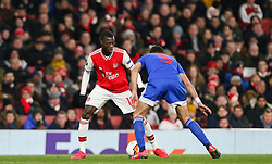 Nicolas Pepe of Arsenal trying to find a way past Andreas Bouhalakis of Olympiacos - Mandatory by-line: Arron Gent/JMP - 27/02/2020 - FOOTBALL - Emirates Stadium - London, England - Arsenal v Olympiacos - UEFA Europa League Round of 32 second leg